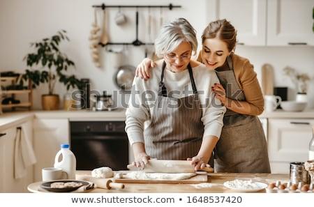 senior · vrouw · genieten · maaltijd · keuken · voedsel - stockfoto © lightpoet