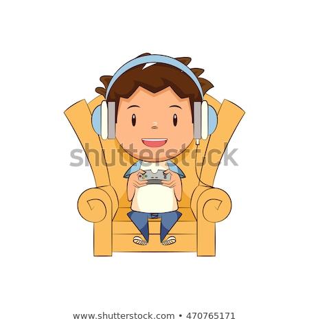 Küçük erkek oynama video oyunları kanepe vektör Stok fotoğraf © pikepicture
