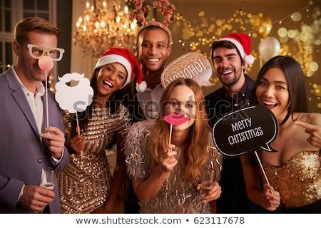 happy couple with party props having fun stock photo © dolgachov