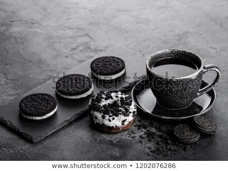 Caffè nero Cup piattino ciambella nero cookies Foto d'archivio © DenisMArt
