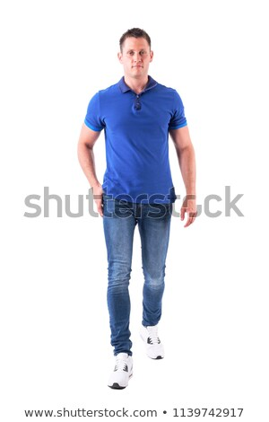 Young attractive man stepping forward Stock photo © feedough