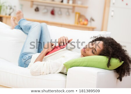 привлекательный · черный · расслабляющая · диван · домой - Сток-фото © Lopolo
