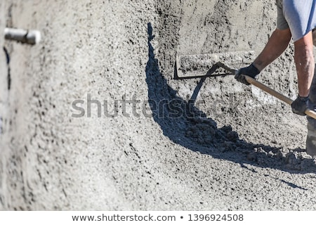 pool construction worker working with a bullfloat on wet concret stock photo © feverpitch