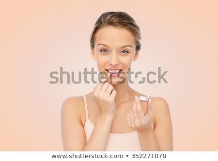 jonge · vrouw · balsem · lippen · glimlachend · gezicht - stockfoto © andreypopov