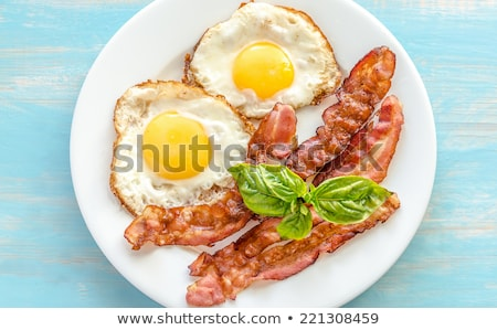 A plate with an egg and a bacon Stock photo © colematt
