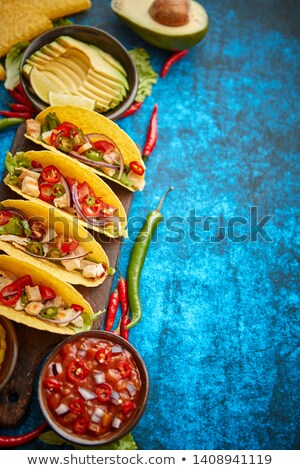 Mexican taco with chicken meat, jalapeno, fresh vegetables served with guacamole Stock photo © dash