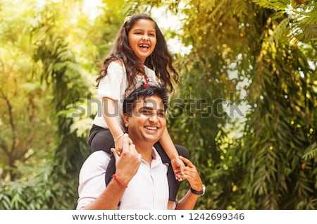 Father and Daughter in a park on summer day Stock photo © Lopolo
