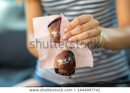 Woman hands cleaning and wiping sun glasses with micro fiber wip Stock photo © adamr