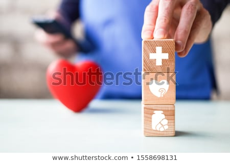 Red heart icon with heartbeat and medical pills for care Stock photo © LoopAll