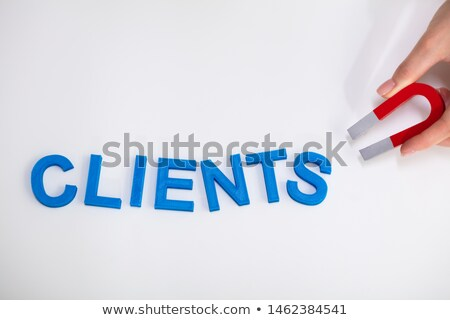 Businessperson Attracting Clients Text With Horseshoe Magnet Stock photo © AndreyPopov