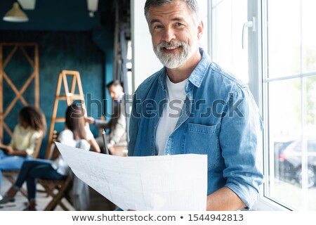 Handsome businessman smiling confidently stock photo © nyul