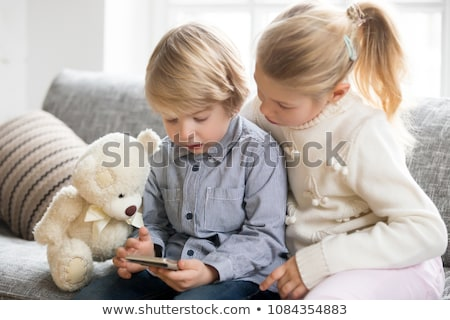 two boys of primary using mobile phone together stock photo © ijeab