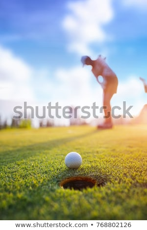 Golf player pitching from bunker. Stock photo © lichtmeister