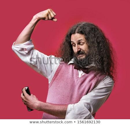 Eccentric man splashing deodorant on a shirt Stock photo © majdansky