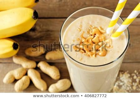 Banana smoothies and bananas on an old wooden background Stock photo © galitskaya