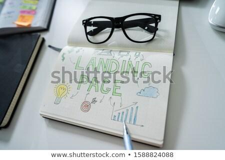 Emberi kéz rajz leszállás oldal notebook közelkép Stock fotó © AndreyPopov