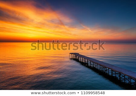 Sunset over the tropical sea. Long exposure shot. Stock photo © moses