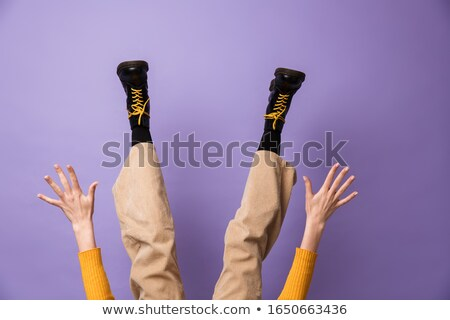 Photo of legs wearing velvet pants and black shoes Stock photo © deandrobot