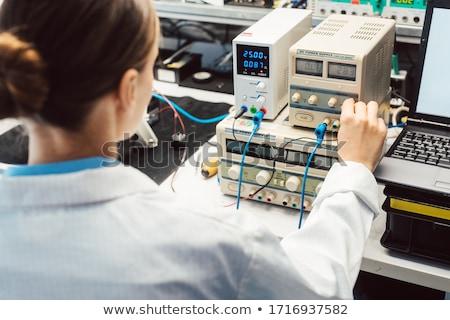 Engineer woman in electronics lab testing EMC compliance Stock photo © Kzenon