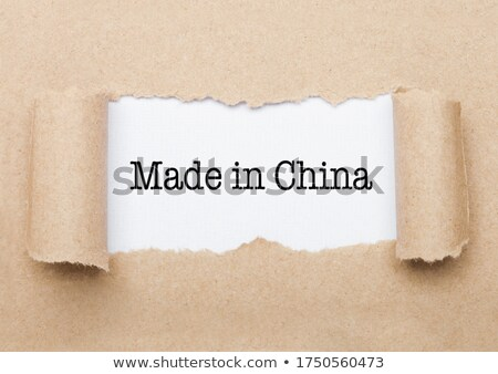 Made in China text appearing behind brown paper  Stock photo © DenisMArt