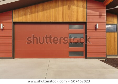 Bright red garage doors stock photo © duoduo