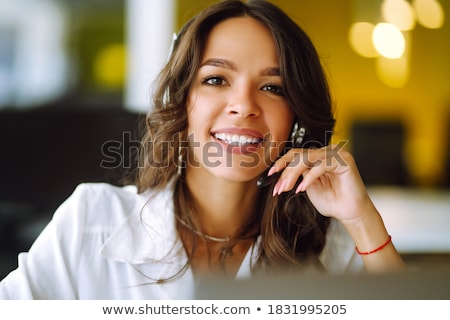 A businesswoman with a headset on. Stock photo © photography33