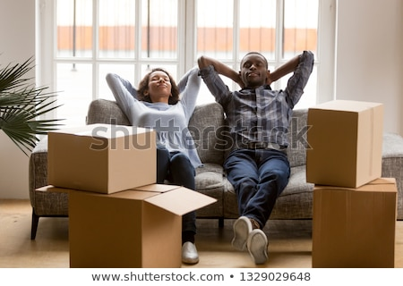 Young women taking a break on moving day Stock photo © photography33
