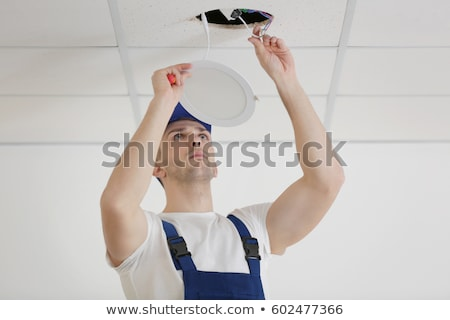 electrician repairing ceiling wiring stock photo © photography33