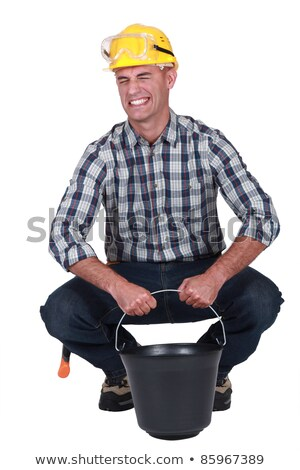 Labourer struggling to lift a heavy bucket Stock photo © photography33