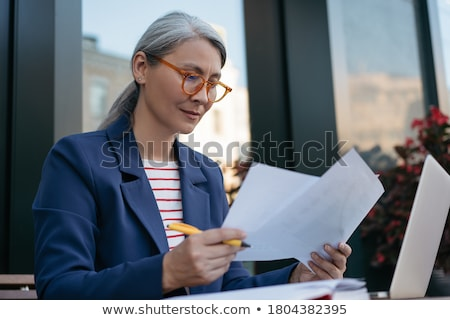 asian businesswoman with documents Stock photo © ambro