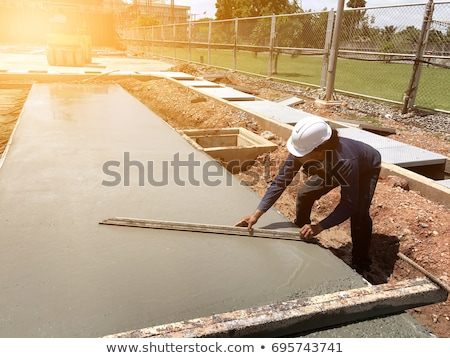 Man spreading concrete foundations Stock photo © photography33