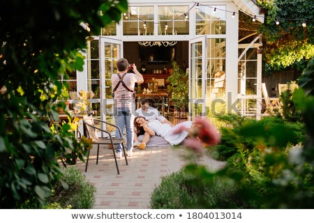 遊園地 · 女性 · 遊園地 · 回転木馬 - ストックフォト © stokkete