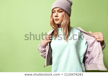 casual woman taking off her jacket stock photo © feedough