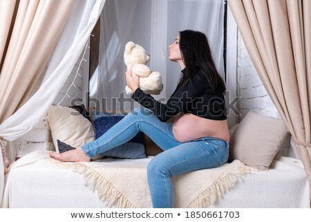 cute pregnant brunette with teddy bear Stock photo © photography33