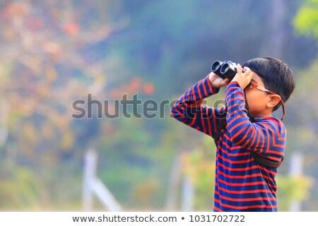 dziecko · lornetki · ciekawy · dziewczyna · uśmiech - zdjęcia stock © compuinfoto