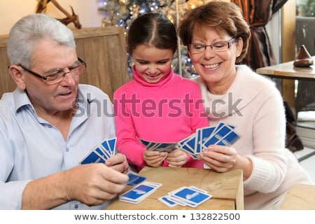 Little girl playing cards with her grandparents Stock photo © photography33