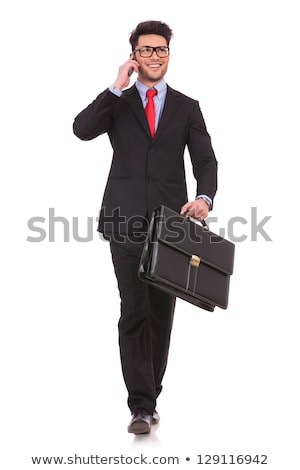 Iş adamı evrak çantası telefon yürüyüş genç Stok fotoğraf © feedough