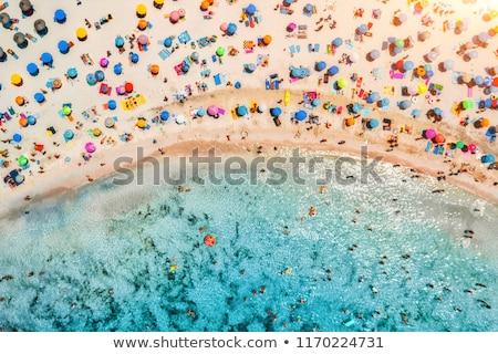Exótico guarda-sol palha guarda-chuva praia tropical praia Foto stock © Kurhan