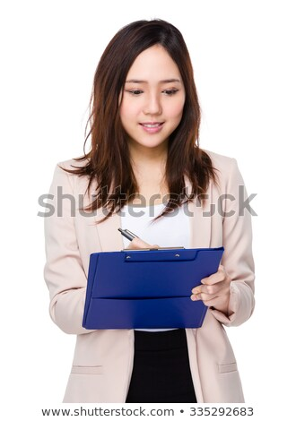 Female secretary jotting down notes on writing pad Stock photo © stockyimages