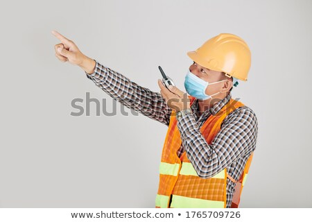 foreman standing in studio using talkie walkie Stock photo © photography33