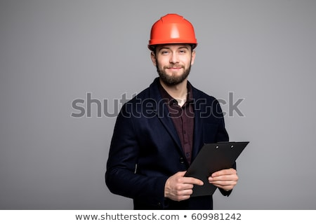 Man in a suit and helmet with folder Stock photo © photography33