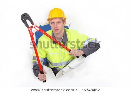 Man with bolt-cutters tearing through background Stock photo © photography33