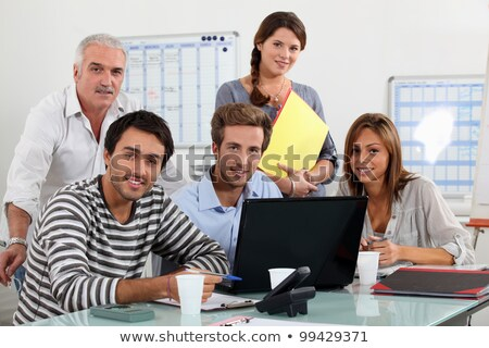Class and teacher gatherd around laptop Stock photo © photography33