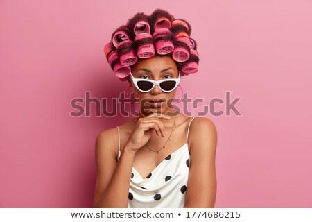 Grave donna foto occhiali giovani Foto d'archivio © dolgachov
