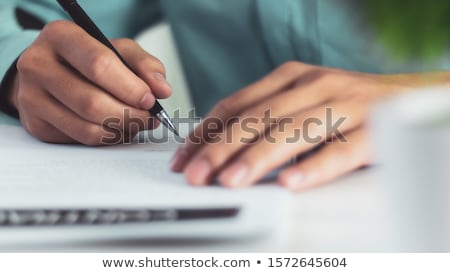 hands writing stock photo © luminastock