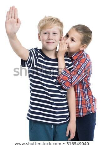 Stock photo: Two twin little sister girls whisper in ear