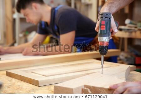 Artisan homme construction fond bleu travailleur Photo stock © photography33