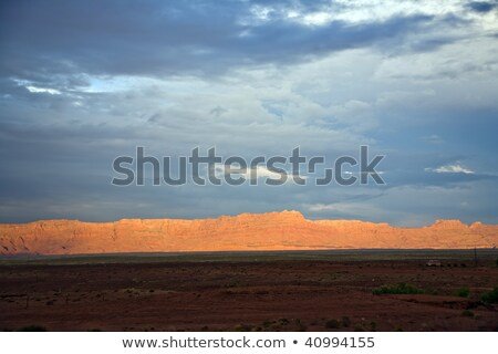 Echo Cliffs with dramatic sky at sunset near Great Canyon Stock photo © meinzahn