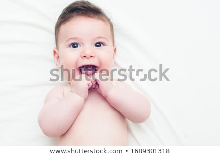 Cute baby lies on bed stock photo © anmalkov
