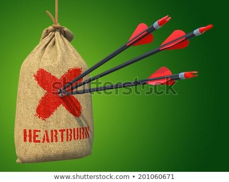 Heartburn - Arrows Hit in Red Mark Target. Stock photo © tashatuvango